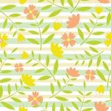 黄色和桔子花无缝的样式在绿色和黄色镶边背景设计织品衣裳背景的 免版税图库摄影