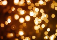 黄色和橙色未聚焦的假日光 免版税图库摄影