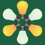 黄色和白光电灯泡 免版税库存图片