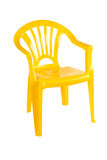黄色塑料椅子 库存照片