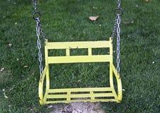 黄色摇摆在公园 库存图片