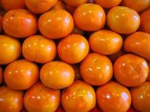 黄色柿子堆 免版税库存图片