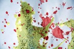 黄色桃红色绿色蜡,闪耀的光,冬天油漆背景 图库摄影