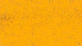 黄色水泥或混凝土墙纹理和背景 免版税库存照片
