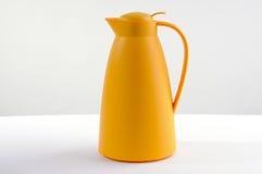 黄色热水瓶 免版税库存图片