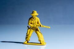 黄色牛仔塑料玩具形象 免版税库存图片