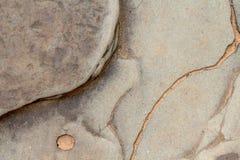 黄色破裂的石纹理照片 古老背景石头 被风化的岩石安心 砂岩风化了 免版税图库摄影