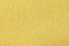 黄色织品背景纹理 纺织材料特写镜头细节  图库摄影