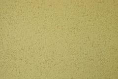 黄色老水泥墙壁混凝土背景 免版税库存图片