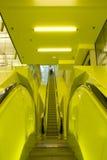 黄色自动扶梯 免版税库存图片