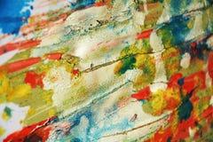 黄色蓝色橙色泥蜡状的背景和刷子冲程,颜色,斑点 免版税库存照片