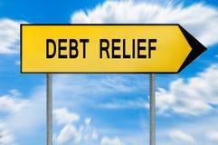 黄色街道概念债务减免标志 免版税库存图片