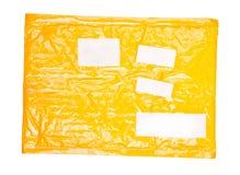 黄色邮件程序包 免版税库存图片