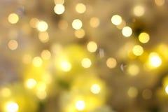 黄色Bokeh光线影响五颜六色的迷离摘要背景 库存照片