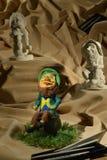 黏土妖精雕塑在布料沙子的 图库摄影