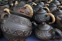 黏土抢劫罐茶壶商品 库存图片