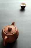 黏土茶杯茶壶 免版税库存照片