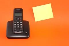 黏着性附注电话 库存图片