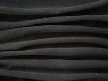 黑丝绸缎纹理,棉织物背景 库存照片