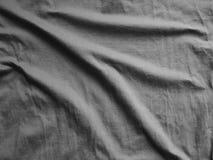 黑丝绸缎纹理,棉织物背景 免版税库存图片