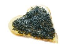 黑人看板卡鱼子酱重点形状华伦泰 库存图片