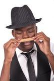 黑人雪茄帽子人性感嗅到佩带 免版税图库摄影