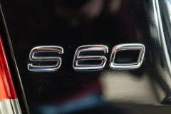 黑使用的富豪集团S60汽车立场后方象征视图在自动陈列室销售的在洗涤以后 图库摄影