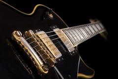 黑吉他 免版税图库摄影