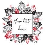 黑和红色叶子印刷品在题字的方形的框架附近设置 库存照片