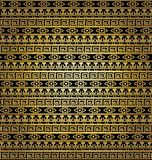 黑暗和金黄装饰品 图库摄影