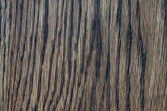 黑暗的垂直的木纹理背景 图库摄影