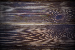 黑暗的木桌平台面视图背景 免版税库存照片