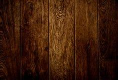 黑暗的木背景 免版税库存照片