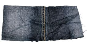 黑暗的牛仔裤织品片断  库存照片