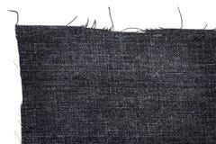 黑暗的牛仔裤织品片断  免版税图库摄影
