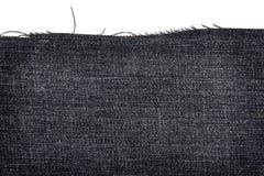 黑暗的牛仔裤织品片断  免版税库存图片