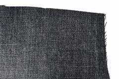 黑暗的牛仔裤织品片断  图库摄影