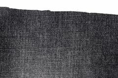 黑暗的牛仔裤织品片断  免版税库存照片