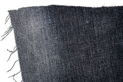 黑暗的牛仔裤织品片断  库存图片
