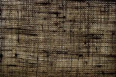 黑暗米黄亚麻帆布的纹理反对光的 免版税图库摄影