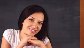 黑板前教师 免版税库存图片