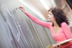 黑板大学生文字年轻人 免版税库存图片