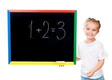 黑板逗人喜爱的女孩一点最近的身分 免版税库存图片
