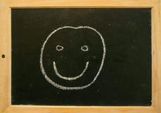 黑板面带笑容 免版税库存图片
