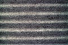 黑概略的波纹状的石棉纹理背景 图库摄影