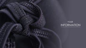 黑泳装胸罩增加串鞋带样式的缝 免版税库存照片