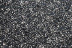 黑海滩沙子用迷离的水 免版税库存照片