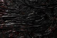 黑熔岩纹理背景 免版税库存照片