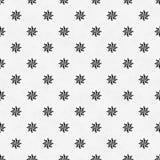 黑白八针对性的轮转焰火星标志瓦片样式 免版税库存照片