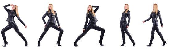黑皮革服装的跳舞的妇女 库存照片
